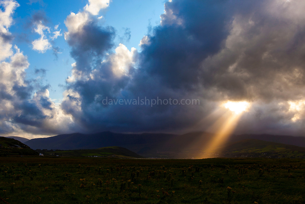 "Sunlight breaks through the clouds above Mount Brandon, near Cloghane. Photo made on Fermoyle Beach, on the Dingle Peninsula, Ireland, This mage can be licensed via Millennium Images. Contact me for more details, or email mail@milim.com For prints, contact me, or click ""add to cart"" to some standard print options."