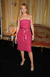 MISS KATE REARDON at a party hosted by Dom Perignon and Vanity Fair magazine to celebrate the launch of a unique collection of essays based on the theme of seduction to raise money for the charity English Pen. The paty was held at the Dom Perignon Mallroom,  13 Grosvenor Crescent, London W1 on 8th September 2004.