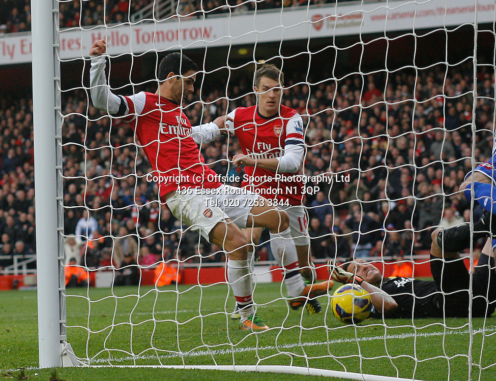 27 October 2012 Premeir League football. Arsenal v Queens Park Rangers.<br /> aaron Ramsey watches as Mikel Arteta pounces to score a goal for Arsenal.<br /> Photo: Mark Leech.