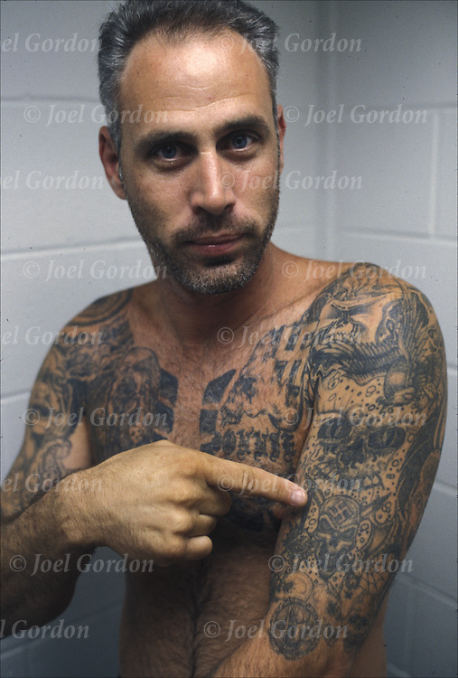 Inmate in Orange County Jail, Aryan Nation, swastika, gang tattoos on chest, body and arms