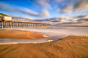 Long exposure of Kitty Hawk Fishing Pier in Kitty Hawk on the Outer Banks of NC.