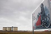Reclame voor de nieuwbouwwijk Zeeburgereiland op IJburg bij Amsterdam.<br /> <br /> A big sign with a cyclist for promoting the new area Zeeburgereiland in Amsterdam.