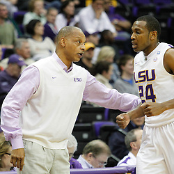 December 29, 2011; Baton Rouge, LA; LSU Tigers head coach Trent Johnson talks with forward Storm Warren (24) during the second half of a game against the Grambling State Tigers at the Pete Maravich Assembly Center.  LSU defeated Grambling State 69-37. Mandatory Credit: Derick E. Hingle-US PRESSWIRE