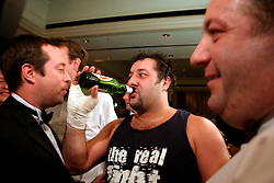UK ENGLAND LONDON 2DEC04 - Boxer John Partridge drinks a beer as he is congratulated by his work colleagues after his fight during the 4th Real Fight Club City Broker Christmas Bash at the London Mariott Hotel, Mayfair. The high-adrenaline contact sport of White Collar Boxing originated in New York 17 years ago and attracts mostly young males from the financial, legal and medical professions.....jre/Photo by Jiri Rezac ....© Jiri Rezac 2004....Contact: +44 (0) 7050 110 417..Mobile:  +44 (0) 7801 337 683..Office:  +44 (0) 20 8968 9635....Email:   jiri@jirirezac.com..Web:    www.jirirezac.com....© All images Jiri Rezac 2004 - All rights reserved.