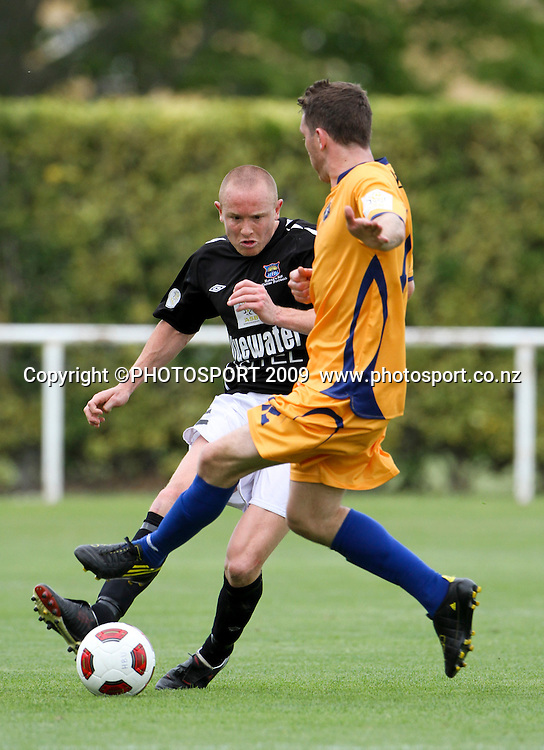 Hawkes Bay's Bill Robertson under pressure. ASB Premiership Football. Hawkes Bay United v Otago. Park Island, Napier 14 November 2010. Photo: Bethelle McFedries / photosport.co.nz
