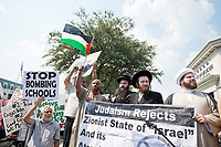 Varied Muslim and Jewish Orthodoxy representatives respond in unified protest of heavy bombing within the Gaza region by Israeli military forces. They call for support of Palestinian rights as well as a stand down in Israeli military strikes. <br />