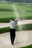 Davis Love III of the US chips blasts out of a bunker toward the 18th green during the third round of the 2005 PGA Championship at Baltusrol Golf Club in Springfield, New Jersey, Saturday 13 August 2005. Love and Phil  Mickelson are now tied for  the lead in the compeition, each shooting 6 strokes under par.
