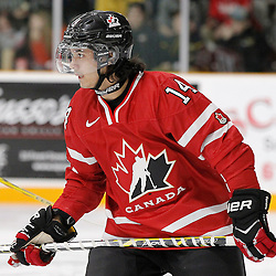 TRENTON, - Dec 10, 2015 -  Exhibition Game 3-  Russia vs Team Canada West at the 2015 World Junior A Challenge at the Duncan Memorial Gardens, ON. Justin Fregona #14 of Team Canada West during the pre-game warmup   (Photo: Amy Deroche / OJHL Images)