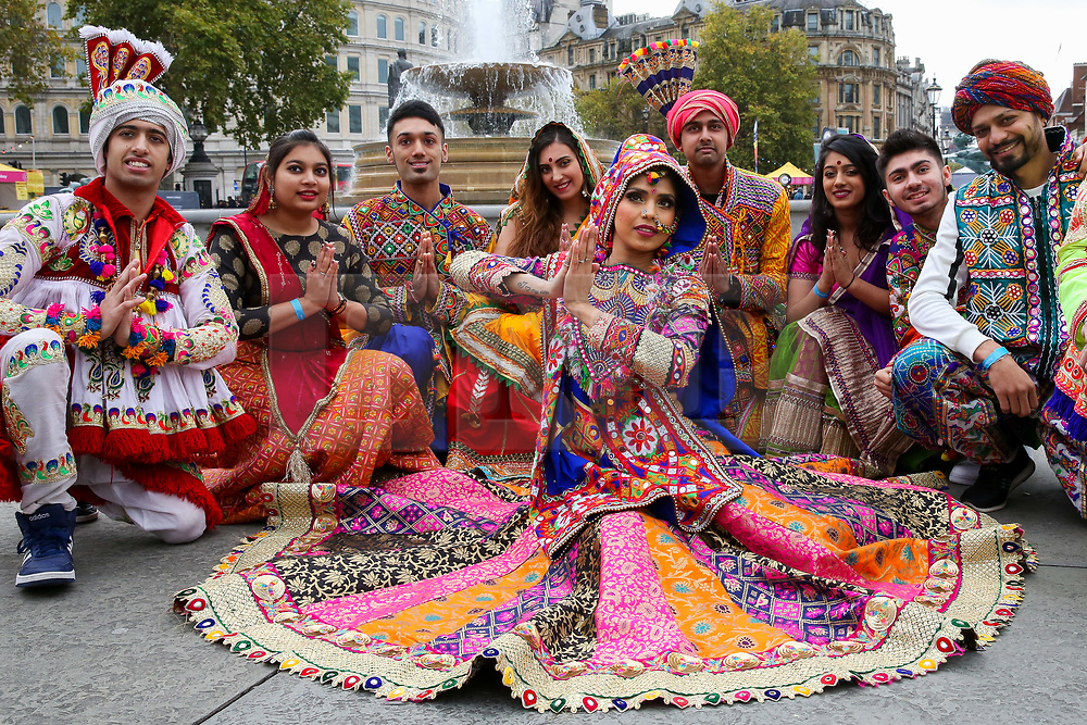 © Licensed to London News Pictures. 03/11/2019. London, UK. Dancers in colourful costumes pose during the Diwali celebrations in London's Trafalgar Square. Hundreds of Hindus, Sikhs, Jains and people from all communities attend Diwali celebrations in London's Trafalgar Square. Diwali s celebrated each year with a free concert of traditional, religious and contemporary Asian music and dance. Photo credit: Dinendra Haria/LNP