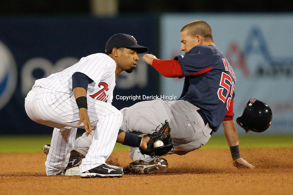 February 27, 2011; Fort Myers, FL, USA; Boston Red Sox center fielder Ryan Kalish (55) slides into second base past Minnesota Twins short stop Alexi Casilla (12) during a spring training exhibition game at Hammond Stadium.  Mandatory Credit: Derick E. Hingle