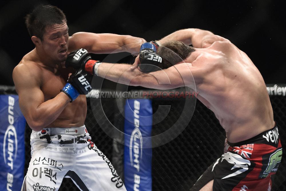 """LONDON, ENGLAND, OCTOBER 2010: Yoshihiro Akiyama (left) and Michael Bisping trade blows during """"UFC 120: Bisping vs. Akiyama"""" inside the O2 Arena in Greenwich, London"""