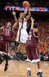 Virginia Cavaliers guard J.R. Reynolds (2) shoots over Virginia Tech Hokies Markus Sailes (24).  The Virginia Cavaliers Men's Basketball Team defeated the Virginia Tech Hokies 69-56 at the John Paul Jones Arena in Charlottesville, VA on March 1, 2007.