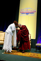 17 May 2013. New Orleans, Louisiana,  USA. .Dr Margaret Wheatley of Tulane University receives a Kata, a Tibetan cloth from His Holiness the 14th Dalai Lama in New Orleans for the 'Resiliance - Strength through Compassion and Connection' conference. .Photo; Charlie Varley.