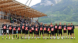 IRDNING, AUSTRIA - Wednesday, May 19, 2010: England players hold up cards reading 'Show Racism The Red Card' before a training session in Irdning as the squad prepare for their World Cup campaign. (Pic by Sandro Zangrando/Expa/Propaganda)