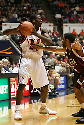 Mamadi Diane (24) protects the ball against a Fordham defender. The Hoos fell to the Rams 62-60...The Virginia Cavaliers fell to the Fordham Rams 62-60 at University Hall in Charlottesville, VA on December 7, 2005.