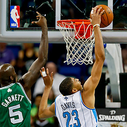 Mar 20, 2013; New Orleans, LA, USA; New Orleans Hornets power forward Anthony Davis (23) rebounds over Boston Celtics center Kevin Garnett (5) during the first quarter of a game at the New Orleans Arena. Mandatory Credit: Derick E. Hingle-USA TODAY Sports