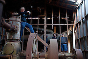 "Andy Carter (left) takes photos inside of a cotton gin that dates back to the 1830s and is rumored to be haunted to follow-up on an investigation. The team brings flashlights, audio recorders, video recorders and night vision cameras to gather evidence of ghosts.  The ""paranormal investigators"" of Twisted Dixie are Grady Carter, Andy Carter, Chris Carter (all related), and Chris Phillips, seen in Antreville, South Carolina November 4, 2011."