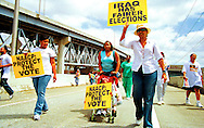 Demonstrators cross the Mississippi River Bridge to march in support of voters rights for displaced Hurricane Katrina evacuees in March 2006