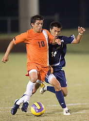 Virginia Cavaliers MF Jonathan Villanueva (10) holds off Mount Saint Mary's Mountaineers F Scott Phinith (14).  The #4 ranked Virginia Cavaliers men's soccer team defeated the Mount Saint Mary's Mountaineers 3-0 at Klockner Stadium in Charlottesville, VA on September 25, 2007.