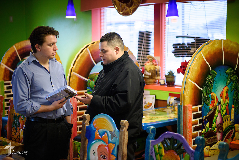 Vicar David Blas, missionary-at-large at LCMS Sheboygan County Hispanic Outreach and St. John's Lutheran Church of Plymouth, Wis., gives a Bible to restaurant operator Hugo Angulo during a visit to the restaurant on Thursday, Jan. 28, 2016, in Plymouth. LCMS Communications/Erik M. Lunsford