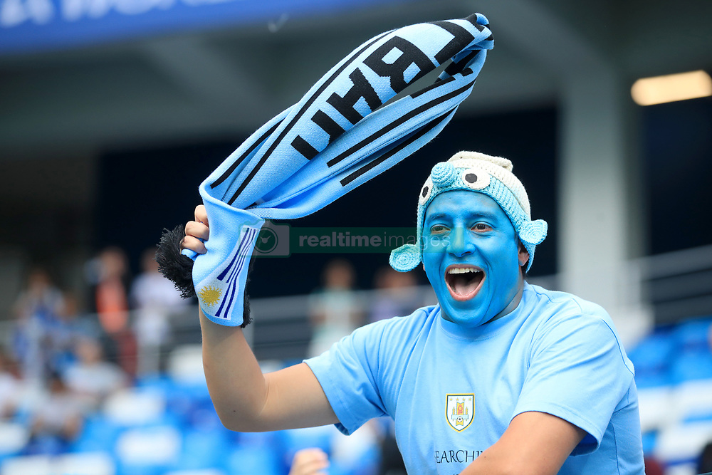 A Uruguay fan shows his support in the stands ahead of the match