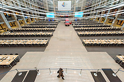 Technicians prepare the atrium of the European Council headquarters building, the day before European leaders convene in Brussels for another EU summit, on Wednesday, Dec. 12, 2012, in Brussels, Belgium. The atrium serves as the main press room during summits.(Photo © Jock Fistick)
