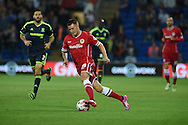Anthony Pilkington of Cardiff city &copy; makes a break. Skybet football league championship match, Cardiff city v Middlesbrough at the Cardiff city stadium in Cardiff, South Wales on Tuesday 16th Sept 2014<br /> pic by Andrew Orchard, Andrew Orchard sports photography.