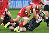 Rugby Union - 2018 / 2019 - European Champions Cup Qualification Final - Ospreys vs Scarlets<br /> <br /> Gareth Davies; of Scarlets tackled by Justin Tipuric (capt)  of Ospreys… at the Liberty Stadium<br /> <br /> Credit: COLORSPORT/WINSTON BYNORTH