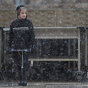 A young ultra-orthodox boy is seen on the plaza as snow and rain fall at The Western Wall on January 7, 2015 in Jerusalem, Israel. (Photo by Elan Kawesch)