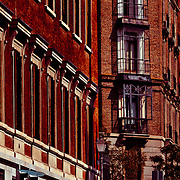 A slice of a buildings brick facade in Central Madrid.