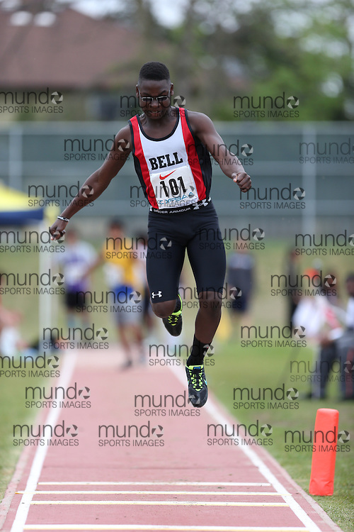 Evander Loney of Bell HS - Nepean competes in the midget boys triple jump at the 2013 OFSAA Track and Field Championship in Oshawa Ontario, Thursday,  June 6, 2013.<br /> Mundo Sport Images / Sean Burges