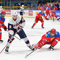 WHITBY, - Dec 17, 2015 -  Game #10 - United States vs. Russia at the 2015 World Junior A Challenge at the Iroquois Park Recreation Complex, ON.  Tanner Laczynski #10 of Team United States skates with the puck while being pursued by Ilia Karpukhin #89 of Team Russia during the second period.<br /> (Photo: Shawn Muir / OJHL Images)