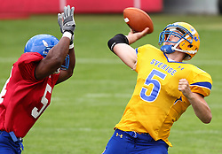 29.07.2010, Brita Arena, Wiesbaden, GER, Football EM 2010, Team Sweden vs Team Great Britain, im Bild Anders Hermodsson, (Team Sweden, QB, #5) wird von Lawrence Reid, (Team Great Britain, DL, #54) bedraengt,  EXPA Pictures © 2010, PhotoCredit: EXPA/ T. Haumer / SPORTIDA PHOTO AGENCY