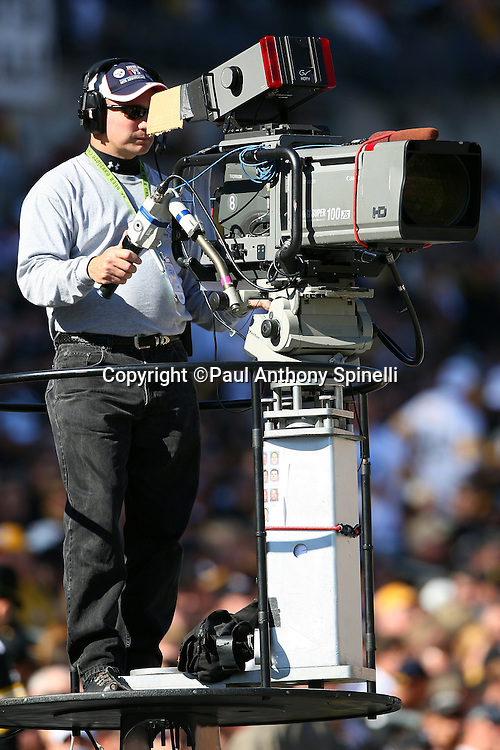 A television cameraman shoots the Pittsburgh Steelers NFL football game against the Minnesota Vikings, October 25, 2009 in Pittsburgh, Pennsylvania. The Steelers won the game 27-17. (©Paul Anthony Spinelli)