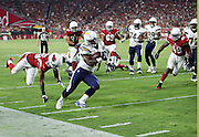 San Diego Chargers running back Branden Oliver (43) runs around the end for a gain of 9 yards while avoiding diving Arizona Cardinals defensive back Chris Clemons (29) during the 2015 NFL preseason football game against the Arizona Cardinals on Saturday, Aug. 22, 2015 in Glendale, Ariz. The Chargers won the game 22-19. (©Paul Anthony Spinelli)