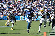Sep 8, 2019; Carson, CA, USA; Indianapolis Colts wide receiver T.Y. Hilton (13) Los Angeles Chargers outside linebacker Thomas Davis (58) a nd defensive back Adrian Phillips (31) at Dignity Health Sports Park. The Chargers defeated the Colts 30-24 in overtime.