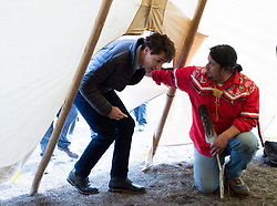 Prime Minister Justin Trudeau enters a teepee for a water cleansing ceremony near Chilko Lake, B.C.,Friday, Nov. 2, 2018. The Prime Minister was in the area to apologize to the Tsilhqot'in community for the hangings of six chiefs during the so-called Chilcotin War over 150 years ago. Photo by The Canadian Press /Jonathan Hayward/ABACAPRESS.COM