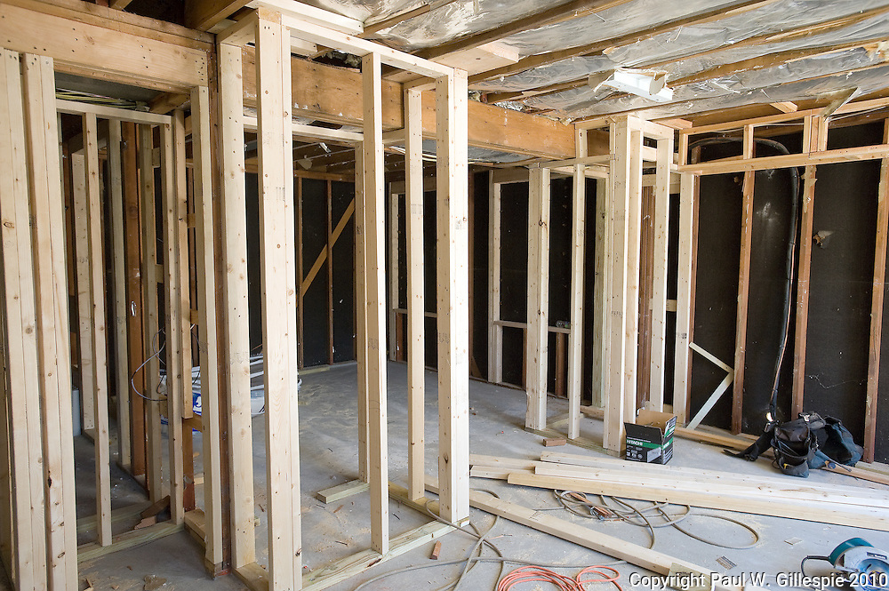 Contractors work on remodeling the Barry home. The Barry family, residing in the Four Seasons development near Gambrills in the western part of Anne Arundel County, has been selected as the second recipient of the MARYLAND HOME MAKEOVERª.  (Photo by Paul W Gillespie) 7/26/10