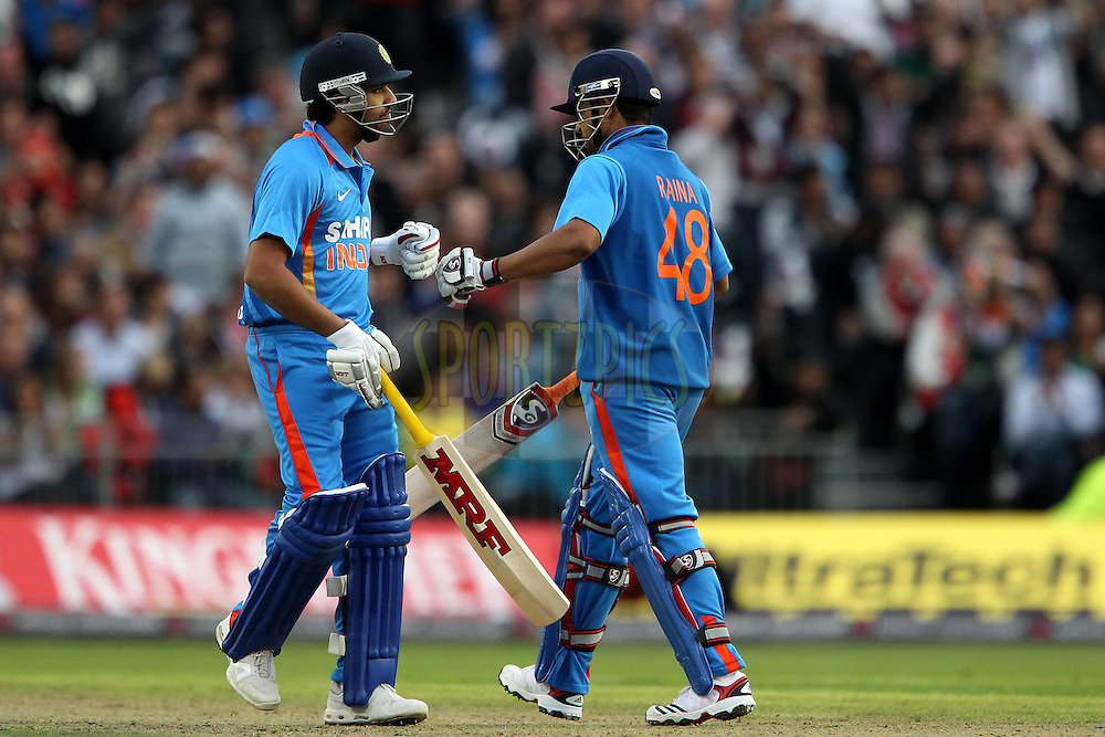 Rohit Sharma and India's Suresh Raina during the International T20 match between England and India held at The Old Trafford Cricket Ground in Manchester, England on the 31st August 2011...Photo by Ron Gaunt/SPORTZPICS/BCCI