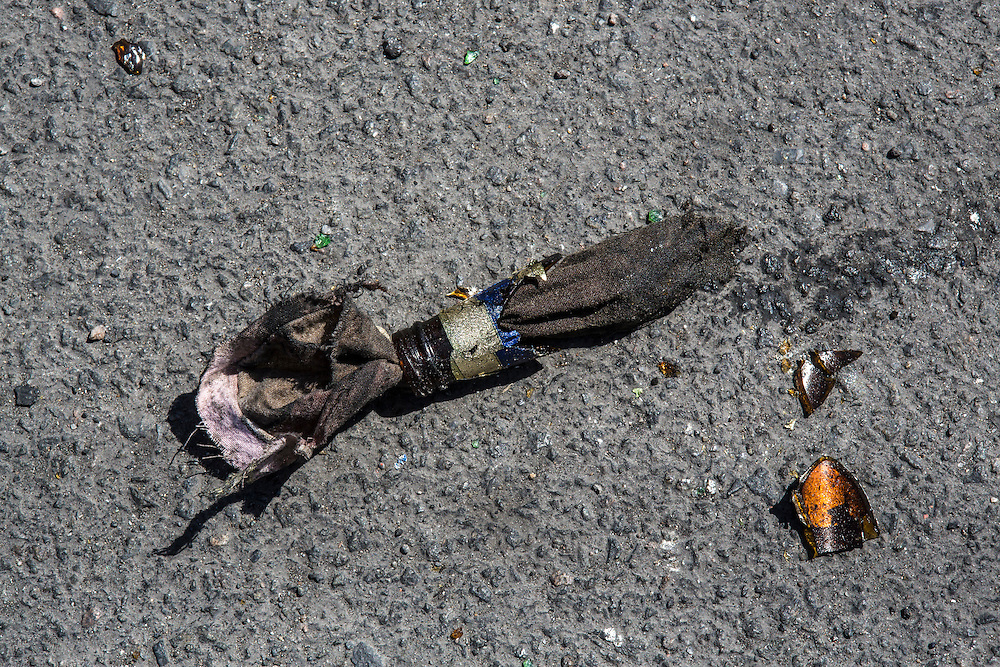 MARIUPOL, UKRAINE - MAY 10: The broken top of a Molotov cocktail lays in the street a day after deadly clashes on May 10, 2014 in Mariupol, Ukraine. A referendum on greater autonomy is planned for the region tomorrow. (Photo by Brendan Hoffman/Getty Images) *** Local Caption ***