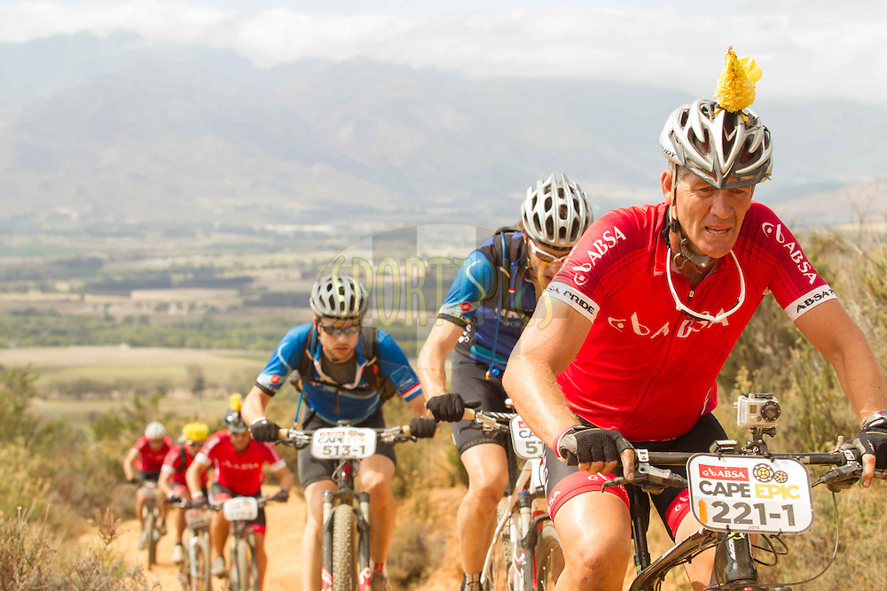 Mark Pieterse leads a bunch of cyclists up a climb during stage 6 of the 2013 Absa Cape Epic Mountain Bike stage race from Wellington to Stellenbosch, South Africa on the 23 March 2013..Photo by Greg Beadle/Cape Epic/SPORTZPICS