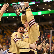 Patrick Brown #23 of the Boston College Eagles and Teddy Doherty #4 of the Boston College Eagles celebrates with The Beanpot following The Beanpot Championship Game at TD Garden on February 10, 2014 in Boston, Massachusetts. (Photo by Elan Kawesch)