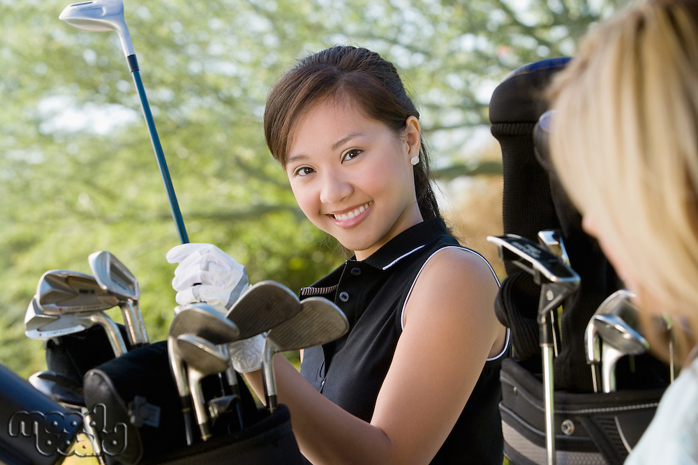 Golfer Selecting Club From Bag