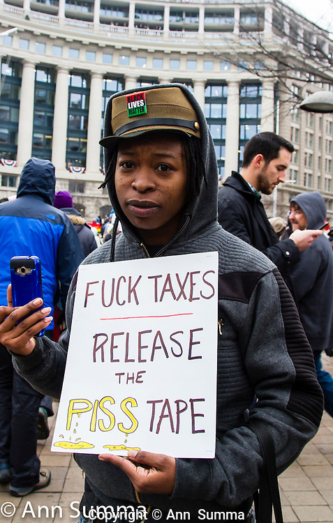 "Washington, DC: ""fuck taxes release the piss tape."" A protest led by the Answer Coaltion drew thousands to Pennsylvania Avenue. Some of the10,000 that were kept out at the security gates later rioted. Others waited 5 hours in line. (Photo; Ann Summa)."