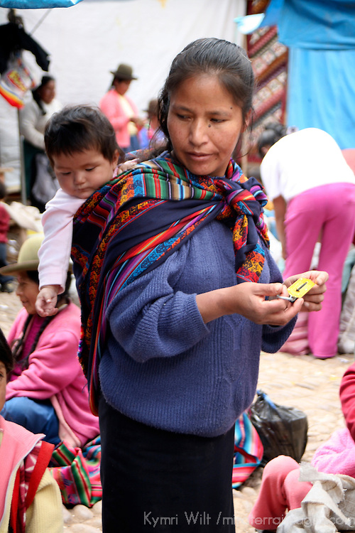 Americas, South America, Peru, Pisac. Young mother and baby at Pisac Market.