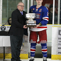 COCHRANE, ON - MAY 4: NOJHL Commissioner Robert Mazzuca presents Peyton Reeves #28 of the Oakville Blades the Dudley Hewitt Cup on May 4, 2019 at Tim Horton Events Centre in Cochrane, Ontario, Canada.<br /> (Photo by Tim Bates / OJHL Images)
