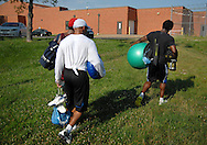 18 JULY 2011 -- ST. CHARLES, Mo. -- Washington Redskins safety Oshiomogho Atogwe (right), and former St. Louis Rams Aeneas Williams (center) and Corey Chavous leave the football field at Francis Howell North High School in St. Charles, Mo. Monday, July 18, 2011 after a workout. Atogwe was training with the former Rams in anticipation of the 2011 NFL season. This will be Atogwe's first season with Washington, after playing six years in St. Louis. Photo © copyright 2011 Sid Hastings.