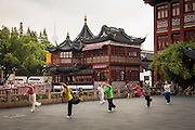 Elderly women practice Tai Chi in front of the Huxinting Teahouse in Yu Yuan Gardens Shanghai, China