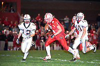 Laconia's David Mahoney is chased down by Will Horan of Plymouth during Friday nights NHIAA Division IV football game under the lights at Laconia High School.  Laconia won the game 30 to 20.   (Karen Bobotas/for the Laconia Daily Sun)