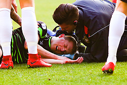 Tom Anderson of Doncaster Rovers receives treatment after colliding with Marko Marosi of Doncaster Rovers - Mandatory by-line: Ryan Crockett/JMP - 24/02/2018 - FOOTBALL - Aesseal New York Stadium - Rotherham, England - Rotherham United v Doncaster Rovers - Sky Bet League One